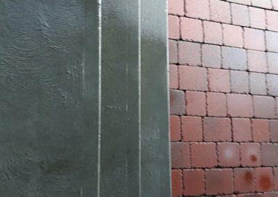 entree livreur restaurant briques beton